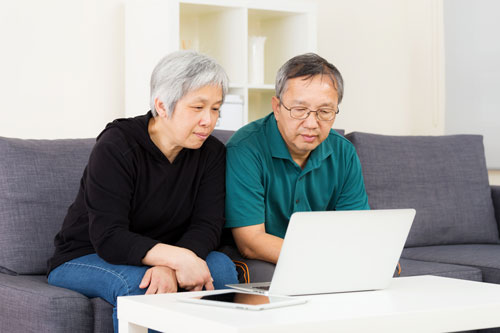 photo of mature couple with laptop