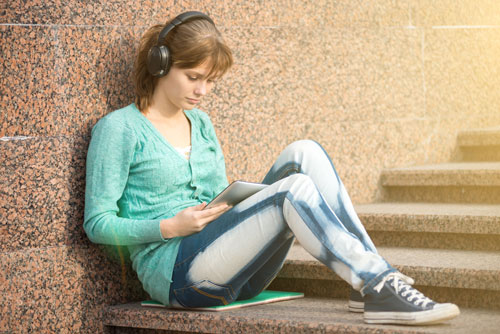 photo of girl with tablet computer