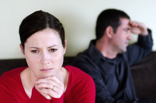 photo of worried couple in dispute